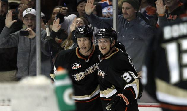Anaheim Ducks left wing Jakob Silfverberg (33), of Sweden celebrates a goal by right wing Tim Jackman, left, during the second period of an NHL hockey game against the Edmonton Oilers on Friday, Jan. 3, 2014, in Los Angeles. (AP Photo/Alex Gallardo)