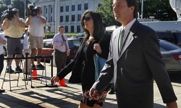 Former Senator and presidential candidate John Edwards and his daughter Cate Edwards enter the Federal Courthouse in Greensboro, N.C. Thursday May 3, 2012. Edwards has pleaded not guilty to six counts related to campaign finance violations over nearly $1 million from two supporters used to help hide his pregnant mistress as he sought the White House in 2008. (AP Photo/The News & Observer, Chuck Liddy)