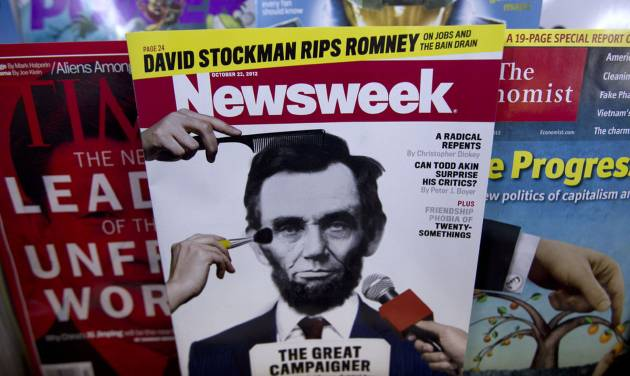 FILE - In this Thursday, Oct. 18, 2012, file photo, a copy of Newsweek is seen at Joe's Smoke, in Portland, Maine. Paper copies of Newsweek will again roll off the presses starting in 2014. Editor-in-Chief Jim Impoco says the news magazine's owners IBT Media want to shift to a business model where a weekly print magazine would be mainly supported by subscription fees instead of advertising.  (AP Photo/Robert F. Bukaty, File)