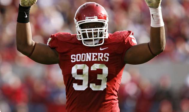 Oklahoma's Gerald McCoy (93) pumps up the crowd during the second half of the Sooners' 33-7 victory over Baylor Saturday at at Gaylord Family-Oklahoma Memorial Stadium in Norman. Photo by Chris Landsberger, The Oklahoman.