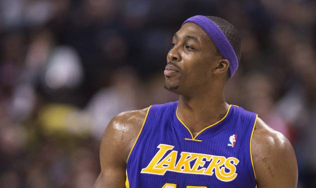 Los Angeles Lakers forward Dwight Howard, right, looks at the referee after being ejected from the game while playing against the Toronto Raptors during first half NBA basketball action in Toronto on Sunday Jan. 20, 2013. (AP Photo/THE CANADIAN PRESS,Nathan Denette)