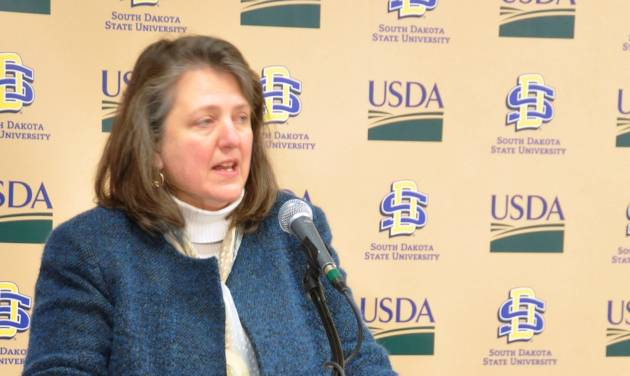 Kathleen Merrigan, deputy secretary for the U.S. Department of Agriculture, introduces more than $75 million in grants to address hunger and food security, Wednesday, Feb. 27, 2013, at South Dakota State University in Brookings, S.D. SDSU will lead a five-year effort to increase the availability of and access to nutritional food. (AP Photo/Dirk Lammers)