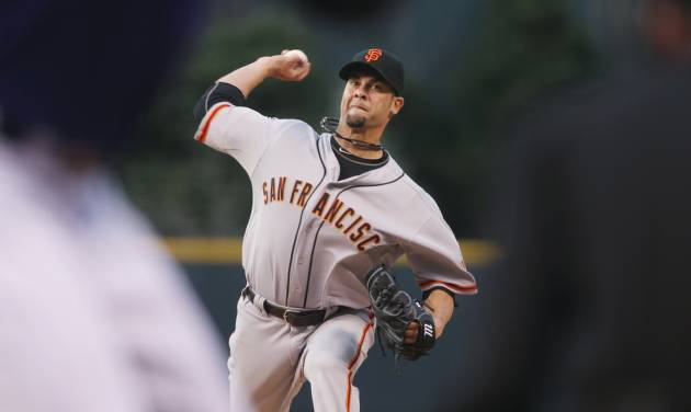San Francisco Giants starting pitcher Ryan Vogelsong works against the Colorado Rockies in the first inning of a baseball game in Denver on Monday, April 21, 2014. (AP Photo/David Zalubowski)