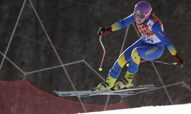 In this Saturday, Feb. 15, 2014 photo, Ukraine's Bogdana Matsotska makes a jump in the women's super-G at the Sochi 2014 Winter Olympics in Krasnaya Polyana, Russia. The International Olympic Committee said on Thursday, Feb. 20, that Matsotska has left the Olympics in response to the violence in her country. (AP Photo/Charles Krupa)
