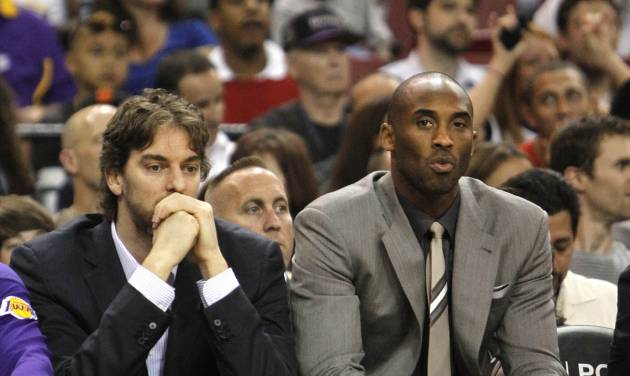Dressed in street clothes, Los Angeles Lakers' Pau Gasol, left, of Spain, and Kobe Bryant watch the first half an NBA basketball game against the Sacramento Kings in Sacramento, Calif., Thursday, April 26, 2012. (AP Photo/Rich Pedroncelli)