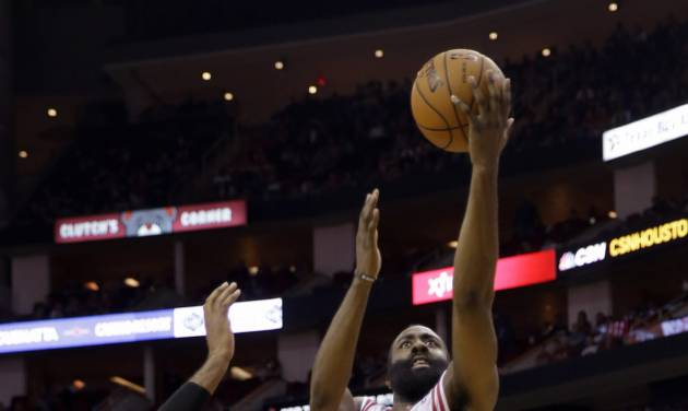 Houston Rockets' James Harden (13) goes up for a shot a Portland Trail Blazers' LaMarcus Aldridge (12) defends during the third quarter of an NBA basketball game Sunday, March 9, 2014, in Houston. The Rockets won in overtime 118-113. (AP Photo/David J. Phillip)