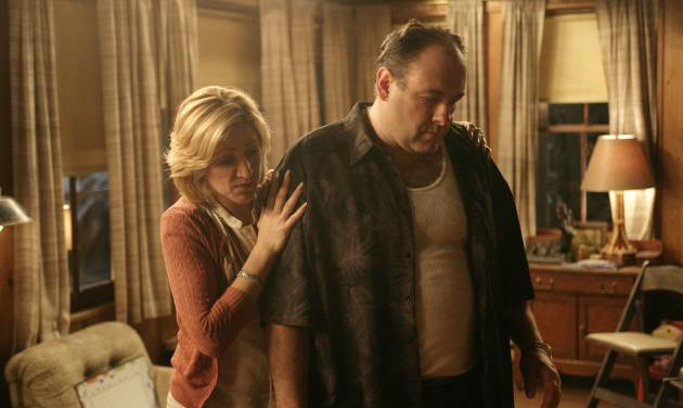 """FILE - In this file photo, originally released by HBO in 2007, Edie Falco portrays Carmela Soprano and James Gandolfini is Tony Soprano in a scene from one of the last episodes of the hit HBO dramatic series """"The Sopranos."""" Amazon is teaming up with HBO, the first such streaming arrangement agreed to by the cable network, in a deal that will make available to Amazon Prime members some classic TV like """"The Sopranos"""" and """"The Wire."""" (AP Photo/HBO, Craig Blankenhorn, File)"""