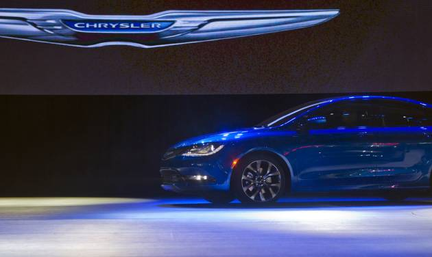 FILE - In this Monday, Jan. 13, 2014, file photo, a Chrysler 200 sedan drives on stage at its introduction,  at the North American International Auto Show in Detroit, Mich. Chrysler reports quarterly financial results before the market open on Wednesday, Jan. 29, 2014.  (AP Photo/Tony Ding)