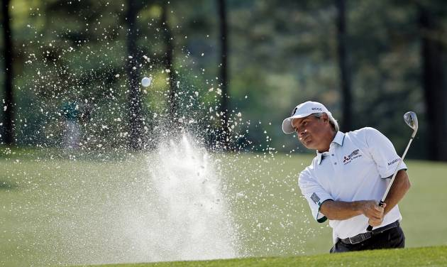 Fred Couples blasts out of a bunker on the 17th fairway during the second round of the Masters golf tournament Friday, April 11, 2014, in Augusta, Ga. (AP Photo/Matt Slocum)