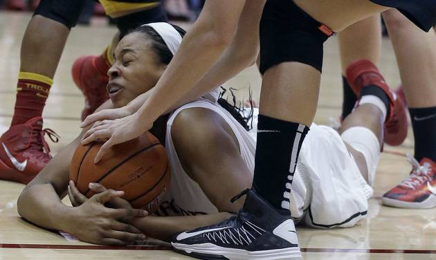 Stanford forward Erica McCall grabs a loose ball under USC players during the second half of an NCAA college basketball game in Stanford, Calif., Monday, Jan. 27, 2014. Stanford won 86-59. (AP Photo/Jeff Chiu)