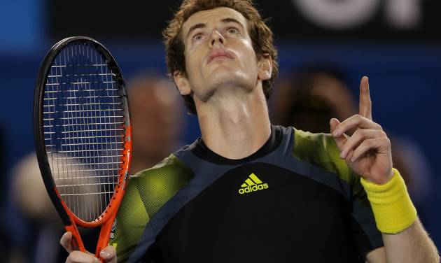 Britain's Andy Murray reacts after winning his men's semifinal against Switzerland's Roger Federer at the Australian Open tennis championship in Melbourne, Australia, Friday, Jan. 25, 2013. (AP Photo/Dita Alangkara)