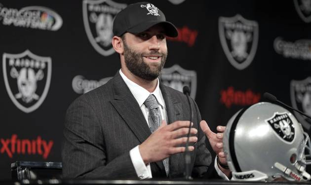 Oakland Raiders quarterback Matt Schaub  gestures while speaking during a news conference Friday, March 21, 2014, at the NFL football team's practice facility in Alameda, Calif. (AP Photo/Ben Margot)