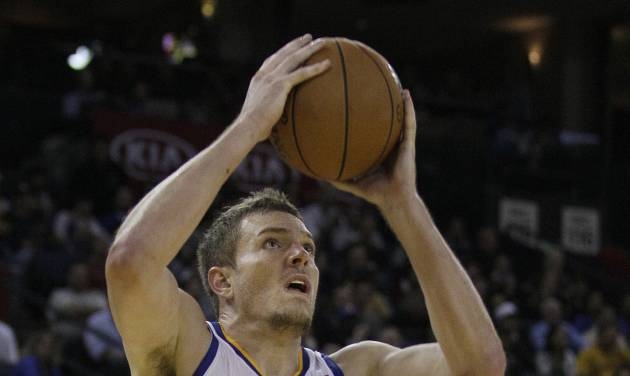 Golden State Warriors power forward David Lee (10) shoots against Cleveland Cavaliers power forward Tristan Thompson (13) during the fourth quarter of an NBA basketball game in Oakland, Calif., Wednesday, Nov. 7, 2012. The Warriors won 106-96. (AP Photo/Jeff Chiu)