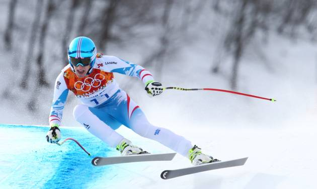 Austria's gold medalist Matthias Mayer makes a turn in the men's downhill at the Sochi 2014 Winter Olympics, Sunday, Feb. 9, 2014, in Krasnaya Polyana, Russia. (AP Photo/Alessandro Trovati)