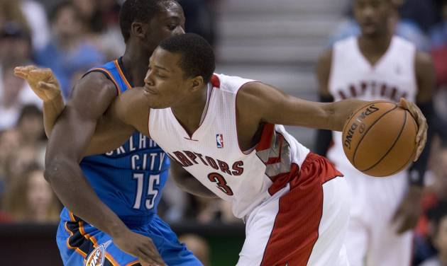 Toronto Raptors guard Kyle Lowry (3) is fouled by Oklahoma City Thunder guard Reggie Jackson (15) during first-half NBA basketball game action in Toronto, Sunday, Jan.6, 2013. (AP Photo/The Canadian Press, Frank Gunn)