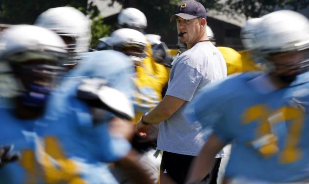 New Putnam CIty West coach Rocky Martin works with his players during spring practice on May 18. Photo by Bryan Terry, The Oklahoman