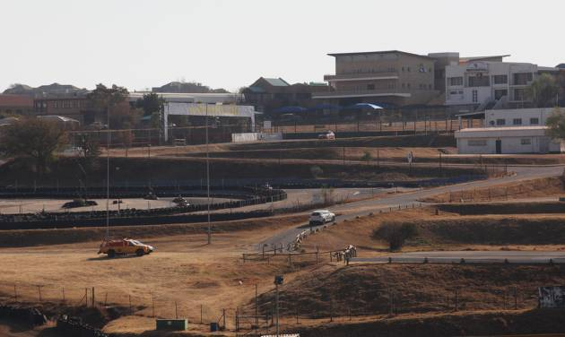 A partial view of the Kyalami race track is seen Thursday July 24, 2014 north of Johannesburg. The South African unit of sports car maker Porsche bought the Kyalami race track for $19.5 million at an auction easing concerns among racing enthusiasts that the winning bidder would tear up the track and build office or commercial buildings in its place. (AP Photo/Denis Farrell)
