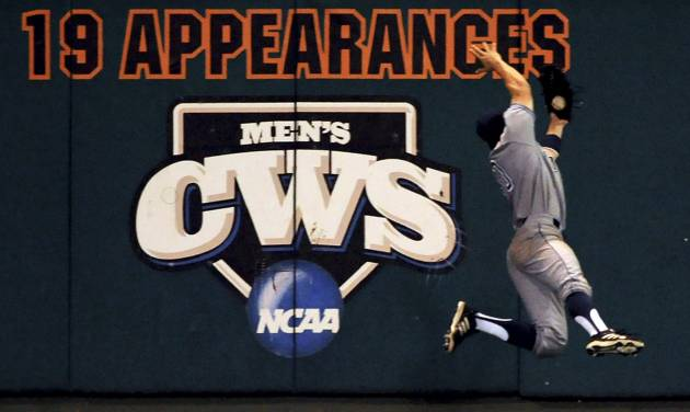 UC Irvine left fielder Adam Alcantara catches an Oklahoma State fly ball at the left field wall for an out during the sixth inning an NCAA college baseball super regional tournament game in Stillwater, Okla, Friday, June 6, 2014. (AP Photo/Brody Schmidt)