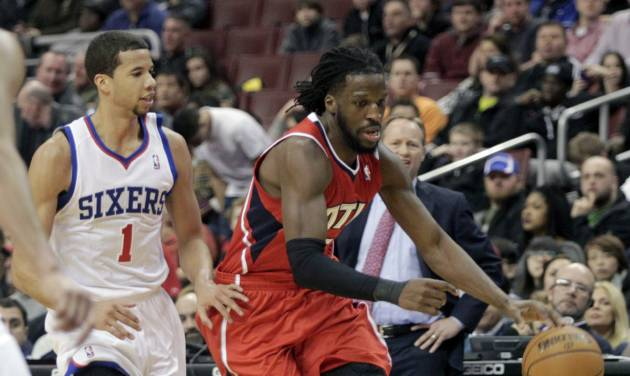 Atlanta Hawks' DeMarre Carroll, right, moves the ball up court as Philadelphia 76ers' Michael Carter-Williams (1) defends in the first half of an NBA basketball game, Friday, Jan. 31, 2014, in Philadelphia. The Hawks won 125-99. (AP Photo/H. Rumph Jr.)