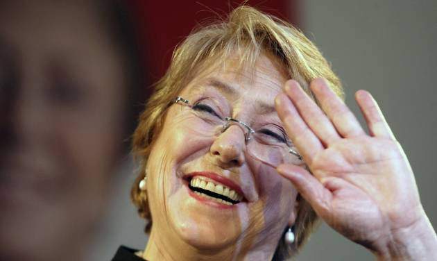 Former President Michelle Bachelet waves to supporters after winning presidential primaries in Santiago,  Chile, Sunday June 30, 2013. Bachelet  won the country's first ever presidential primary and will represent the center-left coalition in November's presidential election. Bachelet, a pediatrician who ended her 2006-2010 presidency with high popularity ratings, won the vote to lead the center-left New Majority coalition with 74 percent of the votes.(AP Photo/Luis Hidalgo)