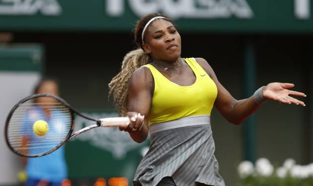 Serena Williams of the U.S, returns the ball to France's Alize Lim during the first round match of  the French Open tennis tournament at the Roland Garros stadium, in Paris, France, Sunday, May 25, 2014. Williams won 6-2, 6-1. (AP Photo/Darko Vojinovic)