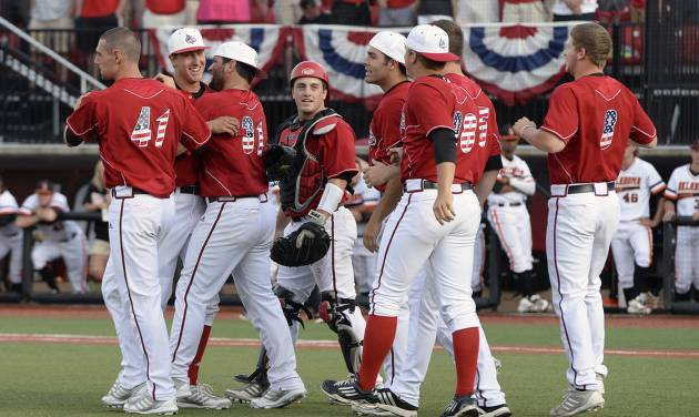 Louisville players celebrate following their 12-3 victory over Oklahoma State in the NCAA college baseball tournament Louisville regional game, Sunday, June 2, 2013, in Louisville, Ky. (AP Photo/Timothy D. Easley)
