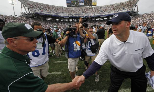 Penn State head coach Bill O'Brien, right, shakes hands with Ohio head coach Frank Solich after an NCAA college football game at Beaver Stadium in State College, Pa., Saturday, Sept. 1, 2012. Ohio won 24-14. (AP Photo/Gene J. Puskar)