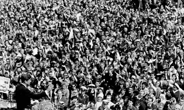 """FILE - In this June 26, 1963 file photo, U.S. President John F. Kennedy, left, waves to a crowd of more than 300,000 gathered to hear his speech where he declared """"Ich bin ein Berliner,"""" (""""I am a Berliner,"""") in the main square in front of Schoeneberg City Hall in West Berlin. (AP Photo/File)"""