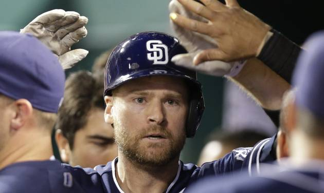 San Diego Padres' Chase Headley is congratulated in the dugout after hitting a solo home run off Cincinnati Reds relief pitcher Aroldis Chapman in the ninth inning of a baseball game, Tuesday, May 13, 2014, in Cincinnati. San Diego won 2-1. (AP Photo)