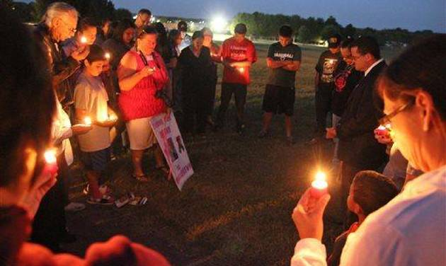 "Cherokee Nation Attorney General Todd Hembree (far right) prays with supporters of the Dusten Brown family on Monday evening, Sept. 23, 2013 in Tahlequah, Okla., after announcing that Veronica Brown had been turned over to her adoptive parents. The transfer came hours after the  Oklahoma Supreme Court dissolved a temporary court order that had kept the child in the Cherokee Nation with her father and his family. Supporters of Brown, the girl's biological father, say he put up a hard-fought battle for the right to keep Veronica but that he ""willfully cooperated"" with the court's order. (AP Photo/Tulsa World, Mike Brown)"