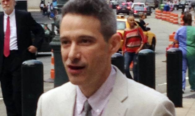 "Beastie Boys rapper Adam ""Ad-Rock"" Horovitz leaves federal court in Manhattan after testifying at a copyright trial stemming from a lawsuit the group brought against a beverage maker over the use of five of its songs in a video, Tuesday, May 27, 2014, in New York.  (AP Photo/Larry Neumeister)"