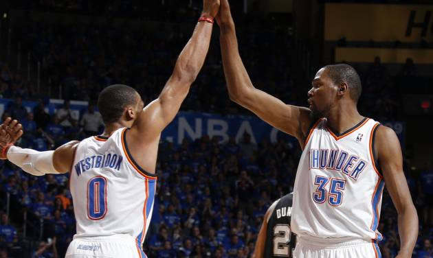 Oklahoma City's Russell Westbrook (0) and Kevin Durant (35) celebrate during Game 3 of the Western Conference Finals in the NBA playoffs between the Oklahoma City Thunder and the San Antonio Spurs at Chesapeake Energy Arena in Oklahoma City, Sunday, May 25, 2014. Photo by Bryan Terry, The Oklahoman