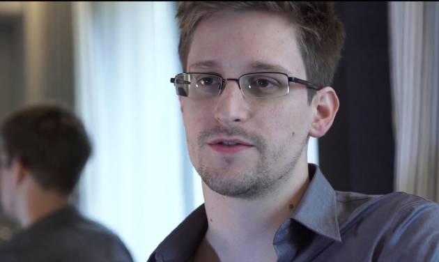 This photo provided by The Guardian Newspaper in London shows Edward Snowden, who worked as a contract employee at the National Security Agency, June 9, 2013, in Hong Kong. U.S. intelligence officials are planning an electronic monitoring system that would tap into government, financial and public databases to scan the behavior patterns of many of the 5 million government employees who hold secret clearances, according to current and former officials. The system draws on a Defense Department model in development for more than a decade, documents reviewed by the Associated Press show. (AP Photo/The Guardian, Glenn Greenwald and Laura Poitras)