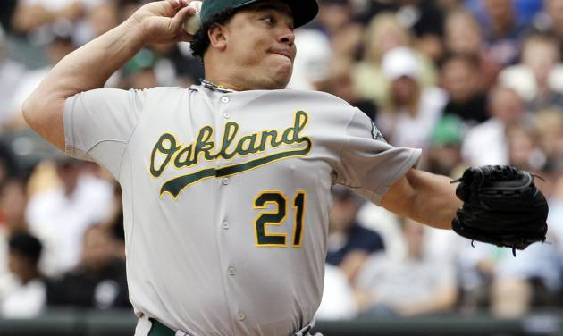 FILE - In this Aug. 12, 2012, file photo, Oakland Athletics starter Bartolo Colon throws against the Chicago White Sox during the first inning of a baseball game in Chicago. Colon, a former AL Cy Young Award winner, has been suspended for 50 games by Major League Baseball on Wednesday, Aug. 22, 2012, after testing positive for testosterone. (AP Photo/Nam Y. Huh, File)