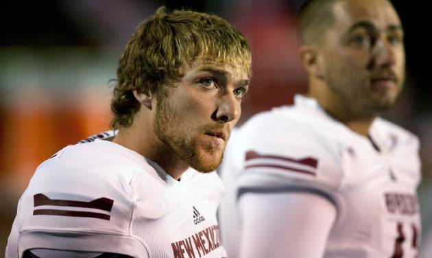 FILE - In this Oct. 5, 2013, file photo, New Mexico State place kicker Maxwell Johnson watches the scoreboard at the end of a 66-17 loss to New Mexico in an NCAA college football game in Albuquerque, N.M. New Mexico State has the nation's longest active streak of losing seasons (11 in a row) and the worst record of any FBS school over the last decade (28-94). Since 1968, they have a grand total of four winning seasons. (AP Photo/Eric Draper, File)