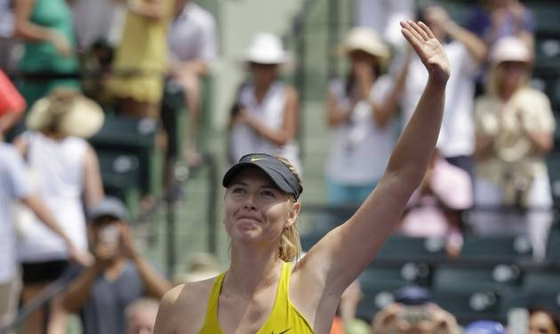 Maria Sharapova, of Russia, waves after defeating Kirsten Flipkens, of Belgium, 3-6, 6-4, 6-1, at the Sony Open tennis tournament, Monday, March 24, 2014, in Key Biscayne, Fla. (AP Photo/Lynne Sladky)