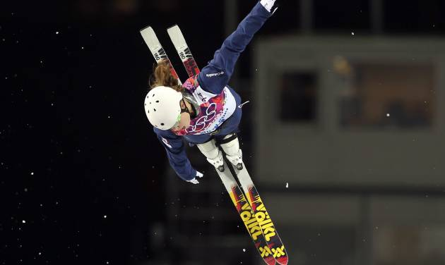 Ashley Caldwell of the United States jumps during the women's freestyle skiing aerials final at the Rosa Khutor Extreme Park, at the 2014 Winter Olympics, Friday, Feb. 14, 2014, in Krasnaya Polyana, Russia. (AP Photo/Sergei Grits)