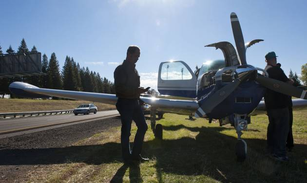 John Mares of Redondo Beach, left, stands next to his Beech BE35-33A airplane after landing it on northbound highway 65 near the Sunset exit in Rocklin, Calif. after having engine trouble, Wednesday, Nov. 14, 2012. Mares says he was testing a new engine on the plane when it lost power at about 3,500 feet, leaving him with no choice but to find a place to land. (AP Photo/The Sacramento Bee, Lezlie Sterling) MAGS OUT; LOCAL TV OUT (KCRA3, KXTV10, KOVR13, KUVS19, KMAZ31, KTXL40); MANDATORY CREDIT