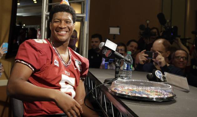 Florida State's Jameis Winston wears a birthday hat as he answers a question during media day for the NCAA BCS National Championship college football game Saturday, Jan. 4, 2014, in Newport Beach, Calif. Florida State plays Auburn on Monday, Jan. 6, 2014. Winston's birthday is Jan. 6. (AP Photo/David J. Phillip)