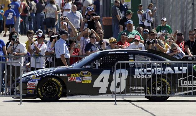Jimmie Johnson (48) drives to his garage after qualifying for the NASCAR Sprint Cup Series auto race at Chicagoland Speedway in Joliet, Ill., Saturday, Sept. 15, 2012. Johnson won the pole with a lap of 29.530 second, 182.865 mph. (AP Photo/Nam Y. Huh)
