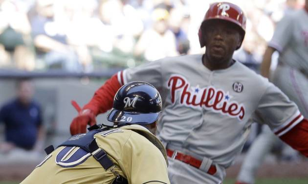 Milwaukee Brewers catcher Jonathan Lucroy tags out Philadelphia Phillies' Jimmy Rollins at home during the seventh inning of a baseball game Thursday, July 10, 2014, in Milwaukee. Rollins tried to score from third on a ball hit by Marlon Byrd. (AP Photo/Morry Gash)