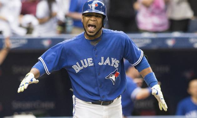 Toronto Blue Jays Edwin Encarnacion celebrates after hitting a walk-off three-run home run against the Milwaukee Brewers during the ninth inning of a baseball game, Wednesday, July 2, 2014 in Toronto. (AP Photo/The Canadian Press, Chris Young)