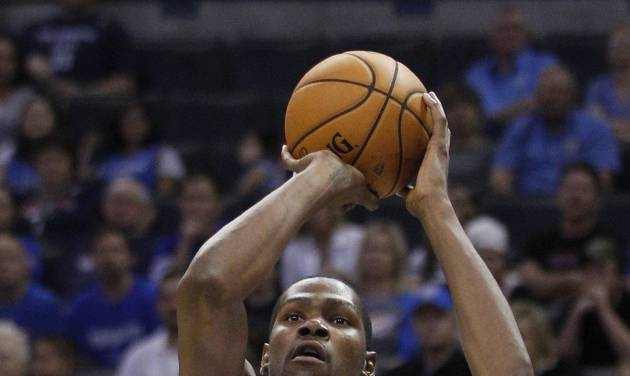 Oklahoma City Thunder forward Kevin Durant (35) shoots over Charlotte Bobcats forward Michael Kidd-Gilchrist (14) during the second quarter of a preseason NBA basketball game in Oklahoma City, Tuesday, Oct. 16, 2012. (AP Photo/Sue Ogrocki)