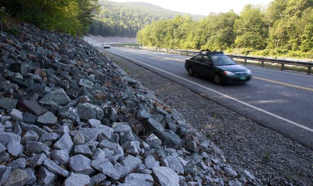 In this Aug. 22, 2013 photo, cars travel on the rebuilt Vermont Route 107 in Bethel, Vt. In what some consider a bit of an engineering marvel, a three-mile section of Route 107 between Bethel and Stockbridge, a major east-west highway that was destroyed by the storm, was rebuilt and reopened in 119 days, a job that normally would have taken two years. Driving in America has stalled, leading researchers to ask: Is the national love affair with the automobile over? After rising for decades, total vehicle use in the U.S. peaked in August 2007. It then dropped sharply during the Great Recession and has largely plateaued since.  (AP Photo/Toby Talbot)