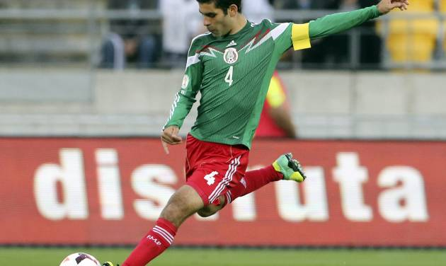 FILE - In this Nov. 20, 2013, file photo, Mexico's Rafael Marquez kicks the ball during his team's World Cup qualifying soccer match against New Zealand at Westpac Stadium, in Wellington, New Zealand. Marquez has made Mexico's World Cup roster for the fourth time. The 35-year-old defender, who captained Mexico at the 2010 tournament, was among 23 players selected Friday by Miguel Herrera, hired last October as El Tri's fourth coach in six weeks. (AP Photo/SNPA, John Cowpland) NEW ZEALAND OUT