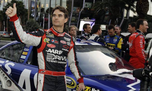 Jeff Gordon waves to fans after driving down the Las Vegas Strip for the Nascar Awards Week victory lap, Thursday, Nov. 29, 2012, in Las Vegas. (AP Photo/Julie Jacobson)