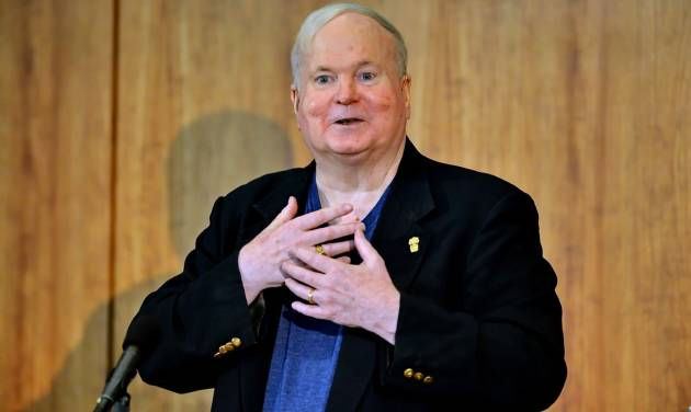 REMOVES REFERENCE TO COLLECTION DONATED - Author Pat Conroy speaks to a crowd during a ceremony Friday, May 16, 2014 at the Hollings Library in Columbia, S.C. in which Conroy announced that his collection of handwritten manuscripts, personal papers and family memorabilia will go to the University of South Carolina. Dean of University Libraries Tom McNally said the archive was acquired for the university through a donation made by USC alum Richard Smith and his wife Novelle in memory of Richard's mother Dorothy. (AP Photo/ Richard Shiro)