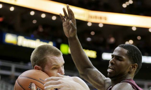 Texas A&M forward Ray Turner, right, tries to steal the ball away from Saint Louis forward Jake Barnett (30) during the first half of an NCAA college basketball game, Monday, Nov. 19, 2012, in Kansas City, Mo. (AP Photo/Charlie Riedel)