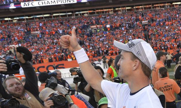 Denver Broncos quarterback Peyton Manning flashes a thumbs up after the AFC Championship NFL playoff football game against the New England Patriots in Denver, Sunday, Jan. 19, 2014. The Broncos defeated the Patriots 26-16 to advance to the Super Bowl. (AP Photo/Jack Dempsey)