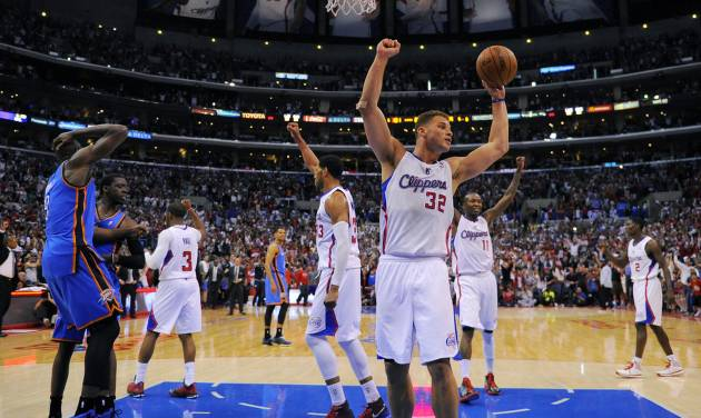 Los Angeles Clippers forward Blake Griffin, center, celebrates along with members of his team as Oklahoma City Thunder forward Serge Ibaka, left, of Congo, and center Ryan Hollins look on as the Clippers win Game 4 of the Western Conference semifinal NBA basketball playoff series, Sunday, May 11, 2014, in Los Angeles. The Clippers won 101-99. (AP Photo/Mark J. Terrill)